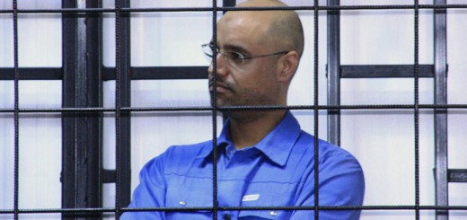 Saif al-Islam Gaddafi, son of late Libyan leader Muammar Gaddafi, attends a hearing behind bars in a courtroom in Zintan May 15, 2014. REUTERS/Stringer (LIBYA - Tags: POLITICS CIVIL UNREST) - RTR3PCA8