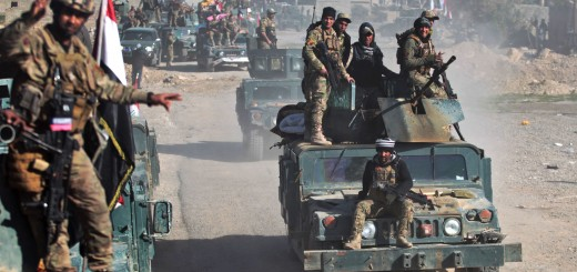 "Iraqi security forces drive in the village of Albu Saif, south of Mosul, after they recaptured the village from the control of the Islamic State (IS) group on February 21, 2017, during the ongoing military offensive to retake the western side of Mosul. Iraqi forces consolidated positions after blasting their way to the southern edge of Mosul in an assault Baghdad and its partners hope will spell the doom of the jihadist ""caliphate"".   / AFP PHOTO / AHMAD AL-RUBAYE"